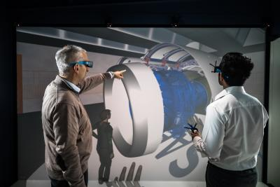 Two people looking at a CAD motor in VR